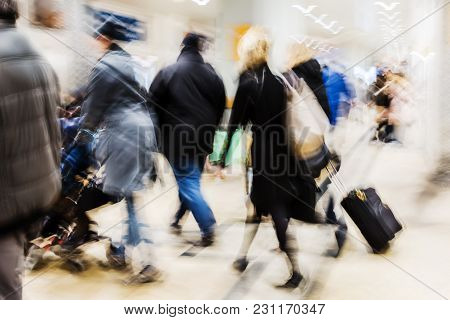Crowds Of People On The Move At A Railway Station With Intentional Motion Blur