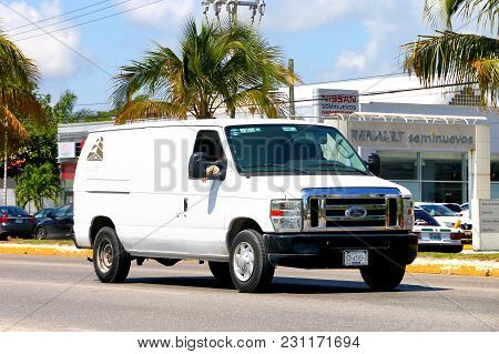 Cancun, Mexico - May 16, 2017: White Cargo Van Ford Econoline In The City Street.