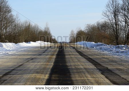 Wide Asphalt Road, On Which There Are Ruts From Cars On The Roadway.
