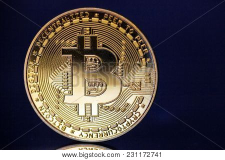 Golden Bitcoin Cryptocurrency On Dark Blue Background