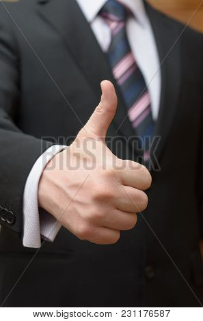 A Businessman In An Expensive Suit Makes A Gesture With His Hand - Everything Is Ok