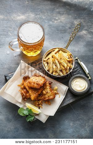 British Fish And Chips With Beer On Dark Background, Top View
