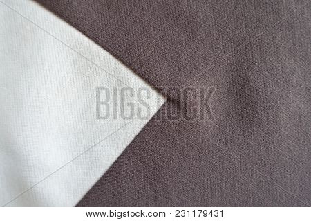 White Triangular Gusset Sewn To Brown Fabric