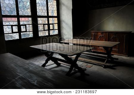 Historical Interior With Wooden Furniture, Decorative Ceiling, Wooden Floor, Paintings On Walls And