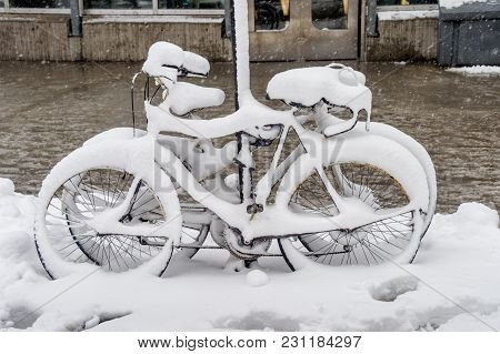 Bike Covered With Fresh Snow In Montreal, Canada, 2018.