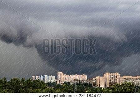 Tornado, Funnel Clouds During A Thunderstorm A Heavy Rain Downpour Over The City