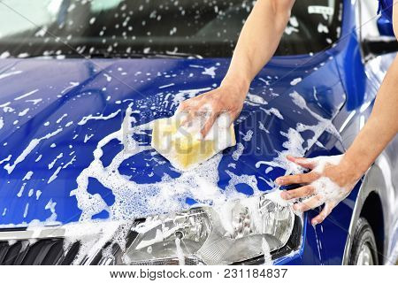 Car Wash - Employees Of A Car Dealership Clean A Vehicle Professionally