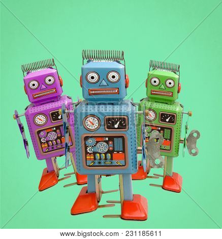 three color confused retro robots on green