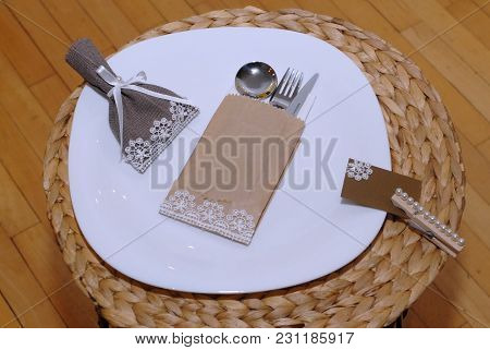 Decorated Straw Plate With Cutlery For Wedding And Other Kinds Of Festivities
