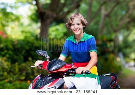 Teenager Riding Scooter. Boy On Motorcycle.