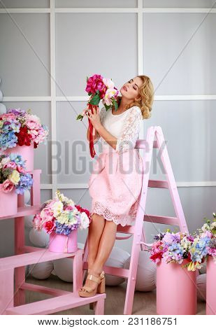 Elegant Sensual Fashion Woman With Flowers In A Spring Blossoming Studio