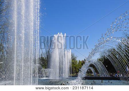 Krasnodar, Russia - May 1, 2017: City Fountain In The City Of Krasnodar. People Are Walking By The F