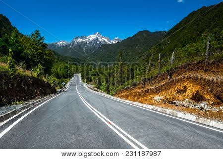 Asphalt road with mountains on the background. Adventure road Carretera Austral (Ruta N7) near the town of Hornopiren, Chile
