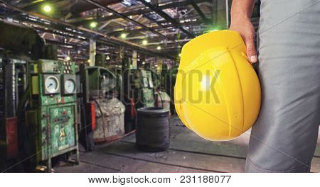 Worker with safety helmet at industrial factory
