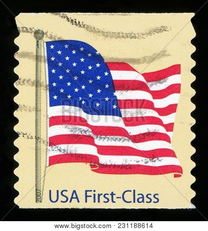 United States - Circa 2007: A Postage Stamp Printed In The United States, Features Waving Usa Flag,