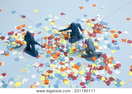 Battle Between Three Plastic Soldiers On A Blue Pop Vibrant Background With Confettis. Minimal Color