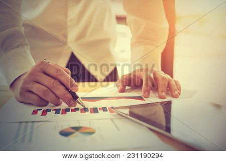 Hand Businessman Working With Documents And Tablet At Office