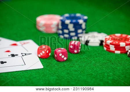 Dice On Casino Gamble Table. Poker Chips And Banknotes On Table In Casino