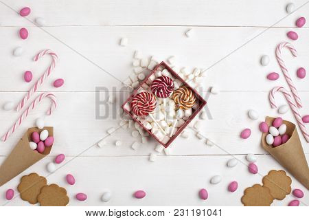 Frame Colorful Candies, Striped Lollipops, Cookies, Marshmallows And Lollipops Gift Top View White W