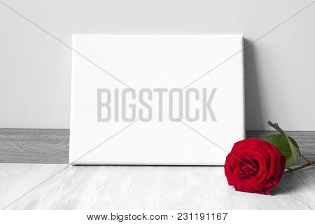 Mock-up Poster Frame And Red Rose. Neutral Gray Wall And Floor On Background.