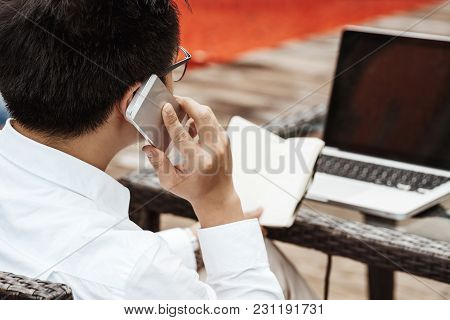Business Concept - Young Business Man Woking On Financial Plan. Strategy Analysis.