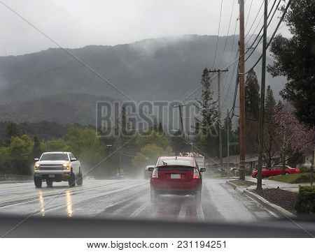 Street With Cars And Trucks In Rain.