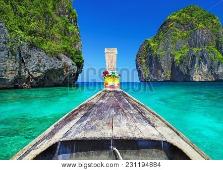 Traditional Wooden Longtail Taxi Boat Nose With Decoration Flowers And Ribbons At Maya Bay Beach Aga