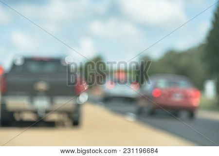 Blurred Image Traffic On Us Highway 59 Caused By Road Construction. Barricades And Large Sewer Pipes