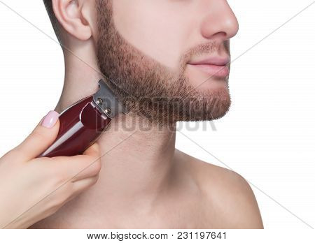 A Male Hairdresser Does A Haircut Of A Beard And A Mustache In A Barbershop.