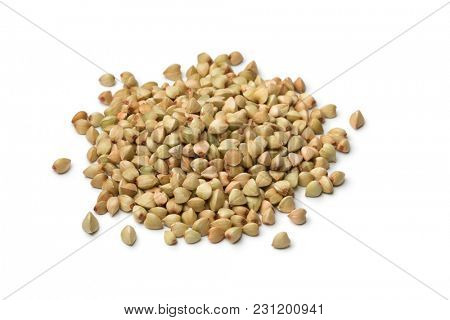 Heap of dried buckwheat seeds isolated on white background