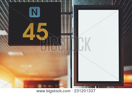 Close-up View Of Empty White Vertical Lcd Screen Mock-up In Departure Area Of Airport Terminal; Blan