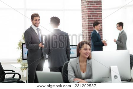 Group of business partners interacting during break