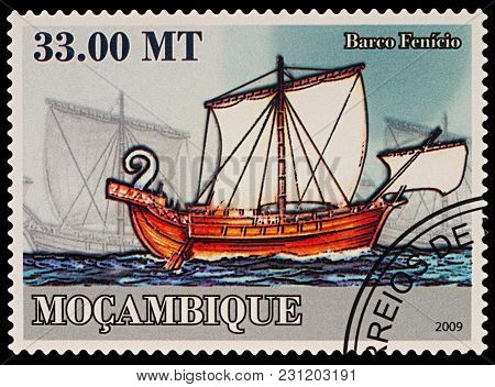 Moscow, Russia - March 14, 2018: A Stamp Printed In Mozambique Shows Ancient Phoenician Sailing Ship