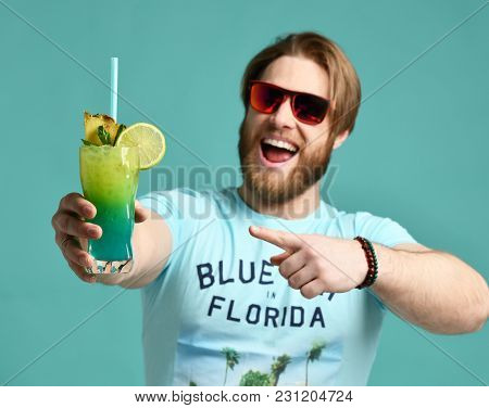 Young Man In Hat Hold Margarita Cocktail Drink Juice Happy Smiling Pointing One Finger At The Camera