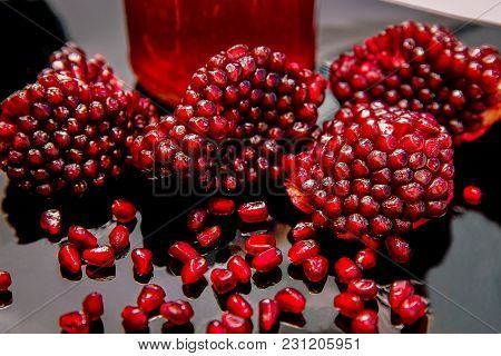 Some Ripe Juicy Red Pomegranate Fruit On The Plate. (punica Granatum)