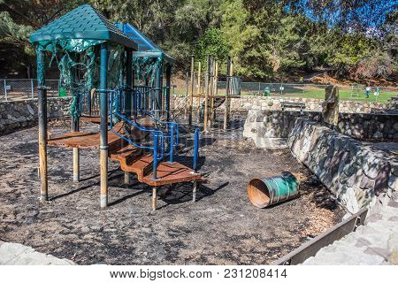 Burnt Playground Equipment Is Melted And Full Of Charred Ash After The Wildfire Spread Through Ventu