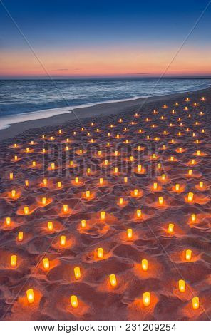Sunset Ocean Sandy Beach Decorated With Lot Flare Lights Of Candles. Marvellous Romantic Sea Vacatio