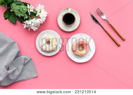 Woman Desk With Flowers, Coffee And Donuts For Breakfast In Spring Desing On Pink Background Flat La