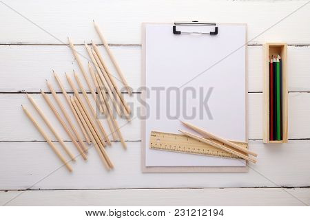 White Clipboard With Blank Paper ,pencils, Ruler And Wood Box On White Wood Background, Template, Mo