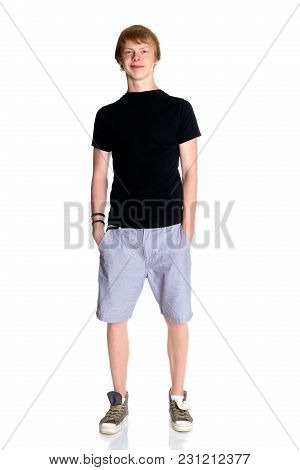 A Young Lean Guy With Red Hair. In A Black T-shirt And Shorts. Isolated On White Background.