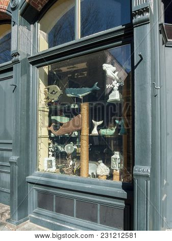 New Bedford, Massachusetts, Usa - March 10, 2018: Whaling Oriented Art Displayed In Window Of Small