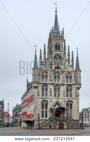 Gouda, Netherlands - March 4, 2018 : The Ancient Cityhall Of Gouda In Winter In The Netherlands