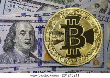 Golden Bitcoin On Hundred Dollar Bills With Shocked Franklin. Cryptocurrency Background