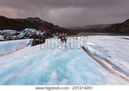 Group Of Hiker Walk On Glacier On Solheimajokull,