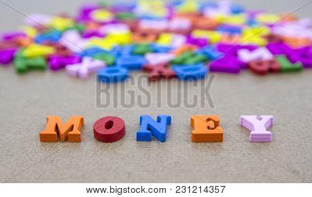 Word Of Money On The Background With Colorful Alphabet