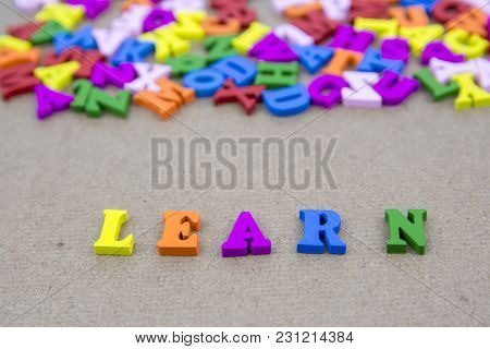 Word Of Learn On The Background With Colorful Alphabet