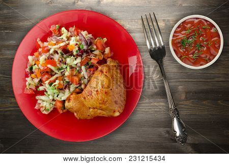 Chicken Wing With Vegetable Salad On A Wooden Background. Chicken Wing With Vegetables On A Plate.