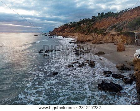Scenic Ocean Beach With Rocks In Malibu, California.