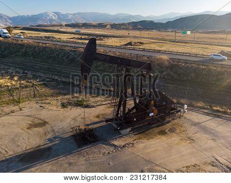 Oil Derrick In The Desers Pumping Wti Oil