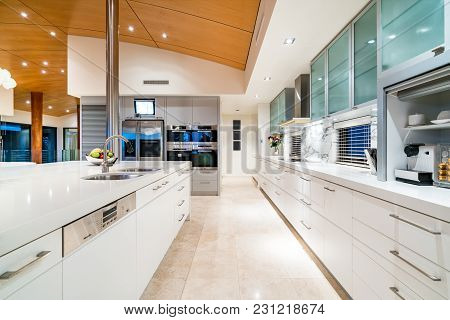 Luxury Kitchen With Stone Bench Tops And Expensive Decor In Million Dollar Home. Perth, Western Aust